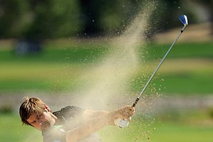 Robert Rock hits a shot on the fifth hole during the final round of the Abu Dhabi HSBC Golf Championship.