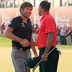 Robert Rock is congratulated by Tiger Woods after winning The Abu Dhabi HSBC Golf Championship.