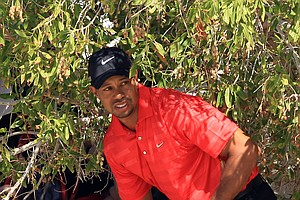 Tiger Woods chipping out of trouble for his third shot on the par-5 2nd hole during the final round of the Abu Dhabi HSBC Championship.