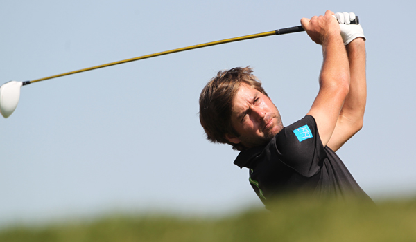 Robert Rock plays a shot during the final round of the Abu Dhabi Golf Championship.
