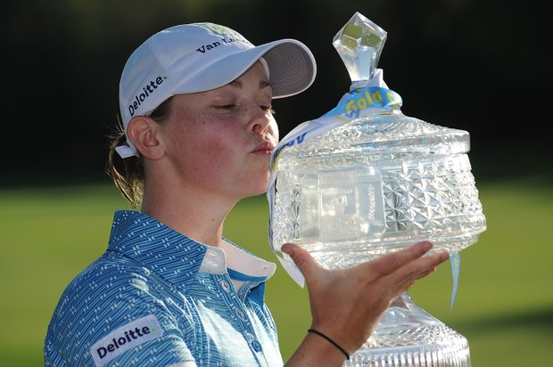 Christel Boeljon of the Netherlands poses with the winners trophy during the 2012 Ladies Masters at Royal Pines Resort.