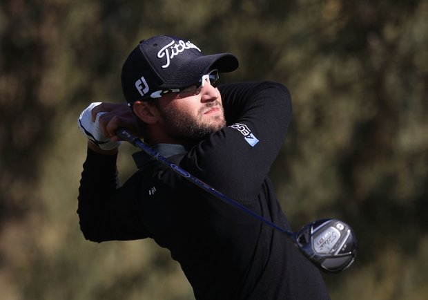 Kyle Stanley hits a tee shot on the second hole during the final round of the Waste Management Phoenix Open at TPC Scottsdale.