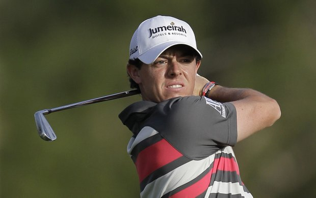 Rory Mcilroy keeps his eye on the ball on the 18th hole during the first round of Dubai Desert Classic golf tournament, in Dubai, United Arab Emirates.