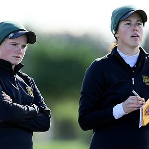 Hayley Davis, left, and Chelsey Cothran, right, watch the action at No. 18. Davis posted an opening round 68.