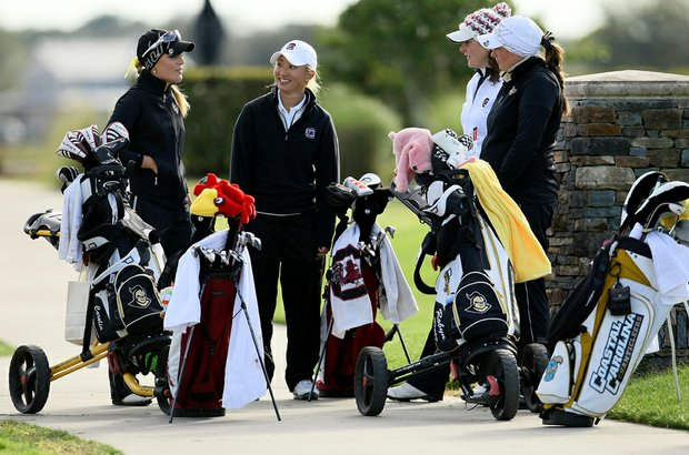 Suzie Lee, center, of University of South Carolina, is surrounded by a few other players as they wait at No. 18 during the first round.
