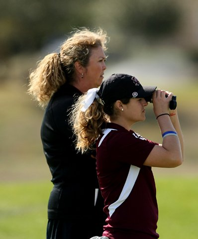 Ally McDonald of Mississippi State with head coach Ginger Brown-Lemm during the second round. Mississippi State is in 14th place at 31-over heading into the final round.