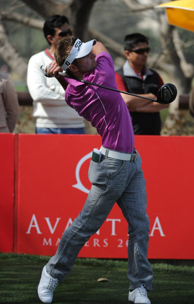 Jbe Kruger of South Africa plays a shot during the final round of the Avantha Masters 2012 at the DLF Golf and Country Club.