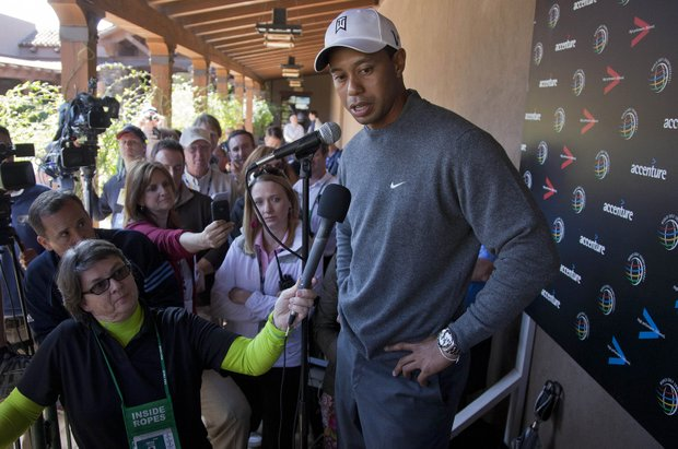 Tiger Woods answers questions for the media during a news conference before playing a practice round at the Match Play Championship.