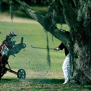 The eventual winner, Chirapat Jao-Javanil  of Oklahoma hits from behind a tree at No. 9. Jao-Javanil won by two strokes.