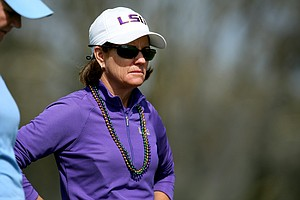 LSU head coach Karen Bahnsen wears her Mardi Gras beads during the final round.