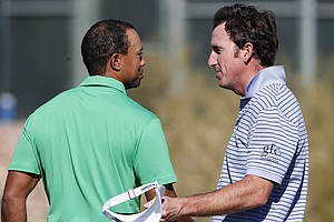 Tiger Woods, left, is congratulated by Spain's Gonzalo Fernandez-Castano, of Spain, after Woods won 1-up in the first round of the Match Play Championship.