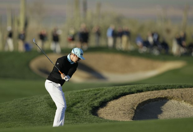 Hunter Mahan hits an approach shot on the second fairway during the Match Play Championship.