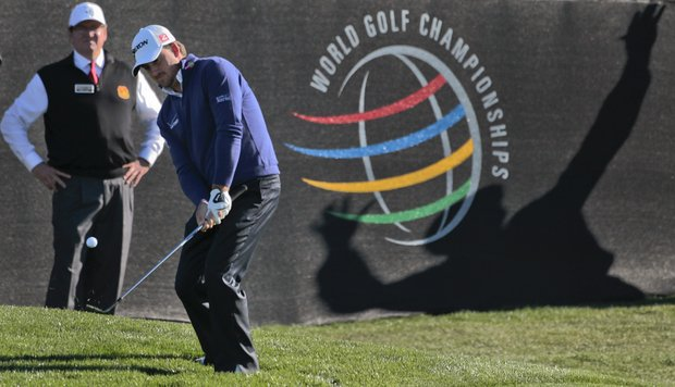 Northern Ireland's Graeme McDowell chips onto the 8th green while playing South Korea's Y.E. Yanng during the Match Play Championship.