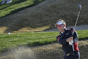 England's Ian Poulter hits out of the sand trap to the third green during the Match Play Championship golf tournament.