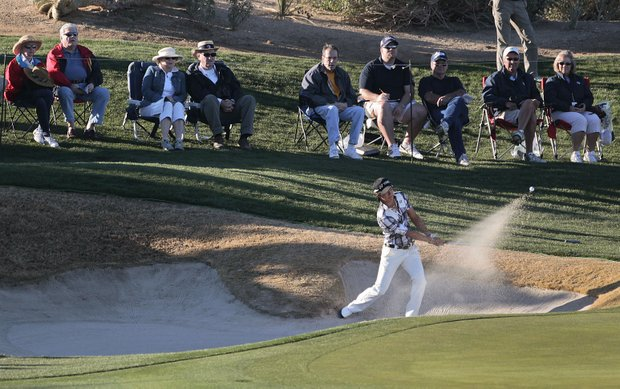 Ryo Ishikawa hits out of the sand trap at the third green in the first round during the Match Play Championship.