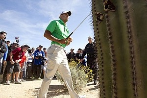 Tiger Woods watches his left-handed shot out of the rough on the second hole during a first round match against Gonzalo Fernandez-Castano at the Match Play Championship.