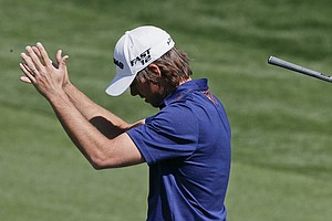 Australia's Aaron Baddeley reacts after a shot while playing Louis Oosthuizen, of South Africa, during the Match Play Championship.