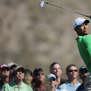 Tiger Woods tees off on the third hold during the Match Play Championship.