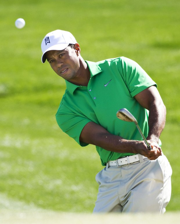 Tiger Woods chips to the second green during at the Match Play Championship.