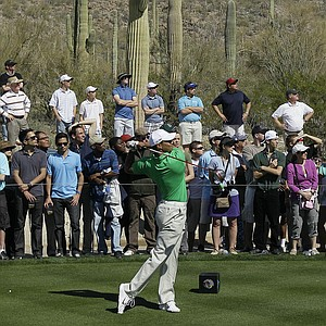 Tiger Woods tees off on the seventh hole during the Match Play Championship.