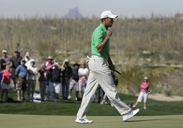 Tiger Woods reacts after sinking a putt on the seventh green while playing Gonzalo Fernandez-Castano during the Match Play Championship.