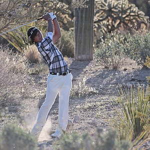 Ryo Ishikawa hits from the rough along the second fairway in the first round during the Match Play Championship.