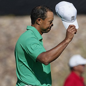 Tiger Woods tips his hat after defeating Spain's Gonzalo Fernandez-Castano during the Match Play Championship.
