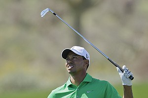 Tiger Woods follows an approach shot on the eighth fairway while playing Gonzalo Fernandez-Castano during the Match Play Championship.