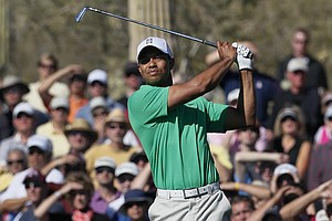 Tiger Woods hits a shot off the 17th fairway while playing Gonzalo Fernandez-Castano during the Match Play Championship.