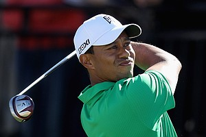 Tiger Woods hits his tee shot on the first hole during the first round of the World Golf Championships-Accenture Match Play Championship.