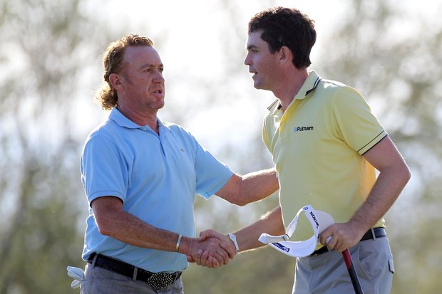 Keegan Bradley, right, and Miguel Angel Jimenez shake hands after Jimenez won their match on the 17th hole during the second round of the WGC-Accenture Match Play Championship.