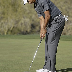 Tiger Woods misses a putt on No. 18 to lose the match to Nick Watney during the Match Play Championship.