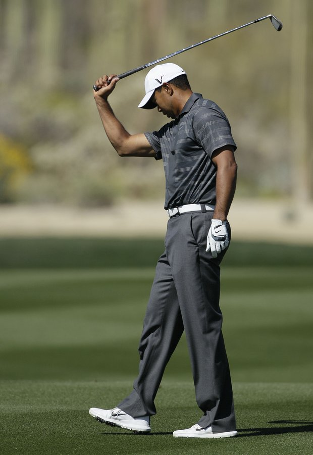 Tiger Woods reacts after a shot on the seventh fairway while playing Nick Watney during the Match Play Championship.