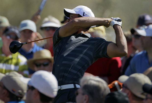 Tiger Woods tees off on 8 while playing Nick Watney during the Match Play Championship.
