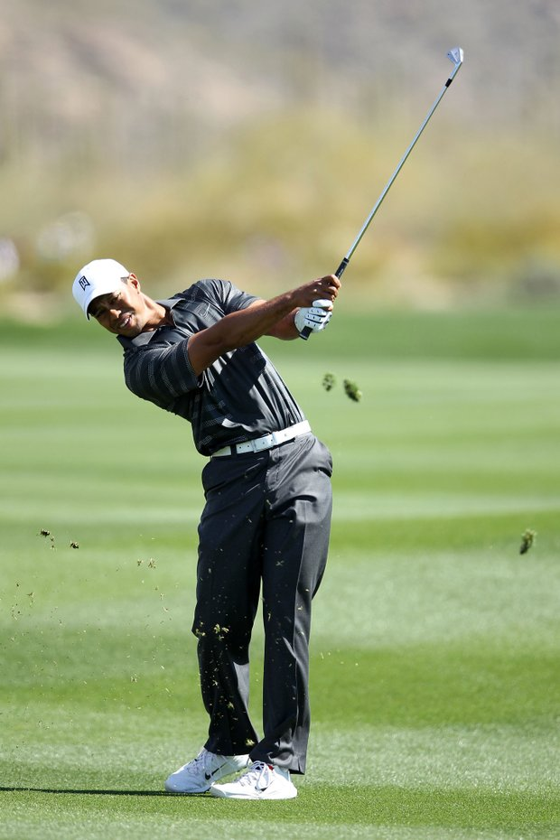 Tiger Woods hits an approach shot on the second hole during the second round of the World Golf Championships-Accenture Match Play Championship.
