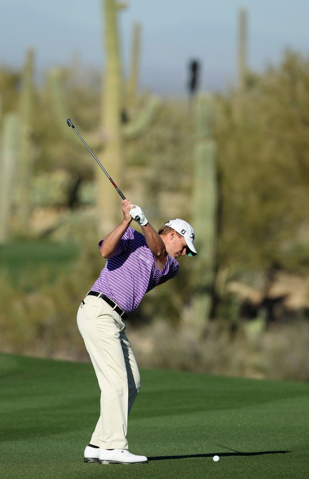 Steve Stricker hits his second shot on the first hole during the second round of the World Golf Championships-Accenture Match Play Championship.