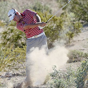 South Africa's Louis Oosthuizen hits out of the rough on the second fairway while playing Steve Stricker during the second round of the Match Play Championship.