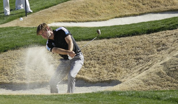 England's Robert Rock hits out of the bunker on three while playing South Korea's Sang-moon Bae during the Match Play Championship.