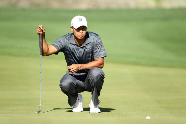 Tiger Woods lines up his putt on the 16th green during the second round of the World Golf Championships-Accenture Match Play Championship.