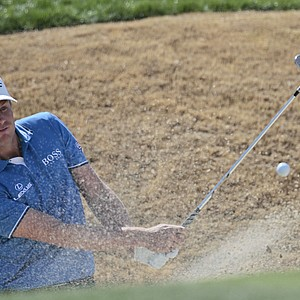 Nick Watney hits out of the bunker on the second hole while playing Tiger Woods at the Match Play Championship.