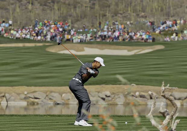 Tiger Woods tees off on four while playing Nick Watney during the Match Play Championship.