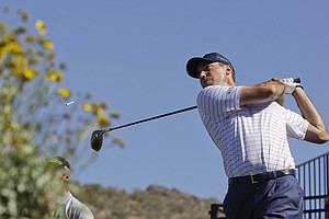 Matt Kuchar tees off of one while playing Martin Kaymer during the Match Play Championship.