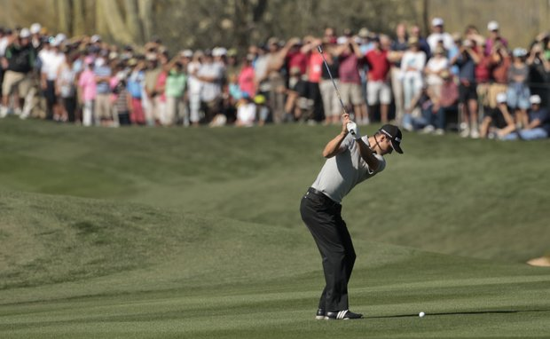 Germany's Martin Kaymer hits from the first fairway while playing Matt Kuchar during the Match Play Championship.