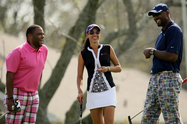 Actor and comedian Anthony Anderson, left, and retired NBA star Alonzo Mourning, far right, share a laugh with  Shasta Averyhardt at the All-Star Celebrity Golf Invitational at Bay Hill Club and Lodge.