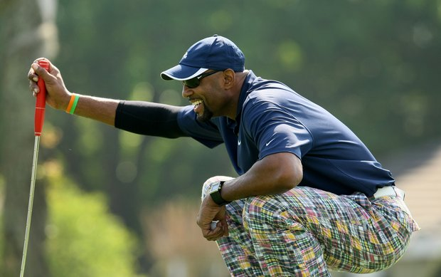 Former NBA star Alonzo Mourning lines up a putt at the All-Star Celebrity Golf Invitational at Bay Hill Club and Lodge.
