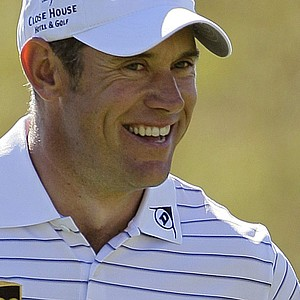Lee Westwood reacts as he walks up to the 15th green while playing Nick Watney during the WGC-Match Play Championship.