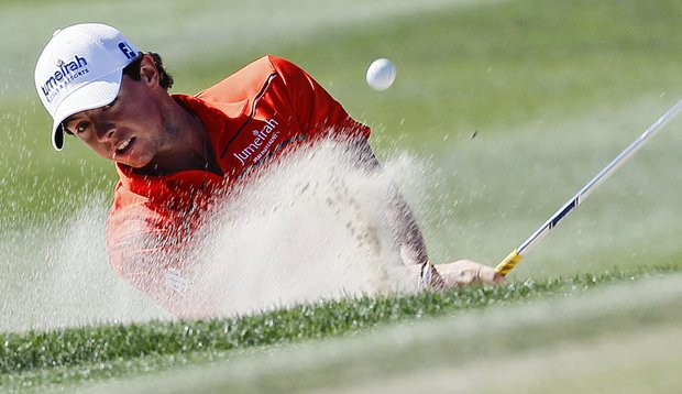 Rory McIlroy hits out of a bunker on the 13th fairway during the WGC-Match Play Championship.