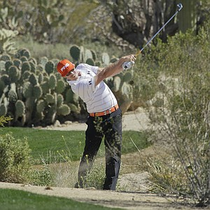 Hunter Mahan hits from the rough while playing Northern Ireland's Rory McIlroy during the Match Play Championship.