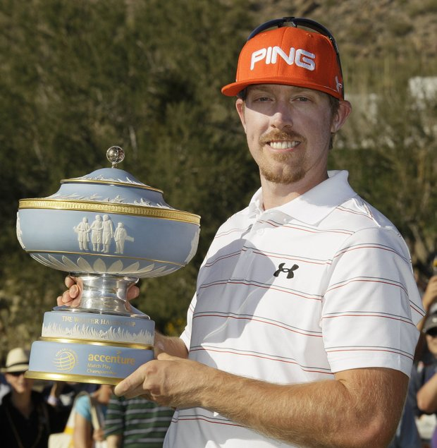 Hunter Mahan poses with the Walter Hagen Cup after defeating Rory McIlroy 2 and 1 to win the Match Play Championship.