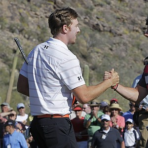 Hunter Mahan, left, shakes hands with Rory McIlroy after defeating him 2 and 1 to win the final round of the Match Play Championship.